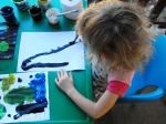 Livvy painting her rocket picture
